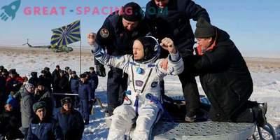 The space capsule returns crew members to Earth