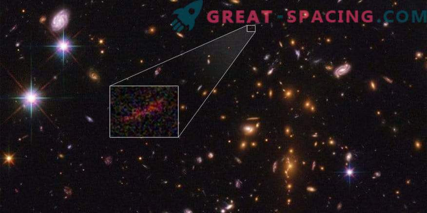 Hubble and Spitzer are combined to get an improved picture of a distant galaxy