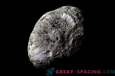 """Cassini is """"Shocked"""" by Saturn's Spongy Companion"""